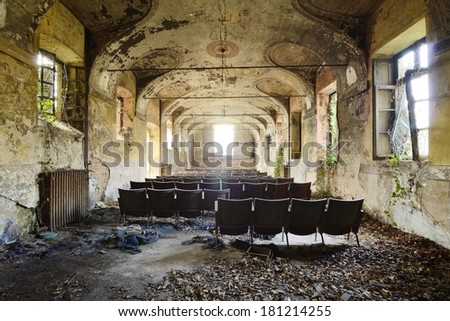 interior of an old abandoned cinema - stock photo