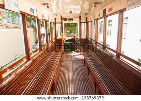 Interior of an old Lisbon tram, Portugal - stock photo