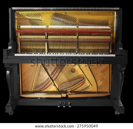 Interior of an old piano - stock photo