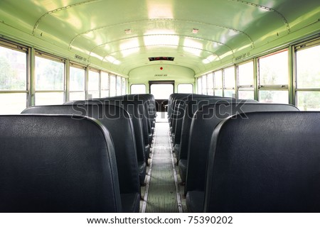 Interior of an old school bus - stock photo