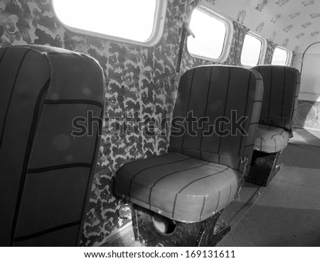 Interior of an old small airplane - stock photo