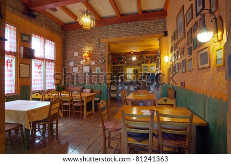 Interior of an old tavern, traditional Serbian style, souvenirs and old wooden furniture.