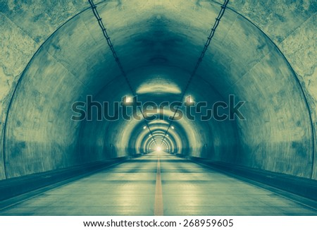Interior of an urban tunnel at mountain without traffic - stock photo