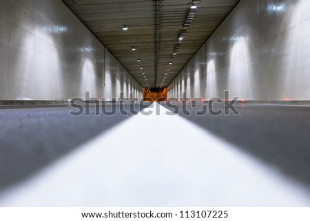 Interior of an urban tunnel without traffic from the ground level - stock photo