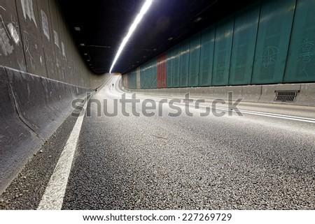 Interior of an urban tunnel without traffic in hong kong modern city at night  - stock photo