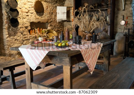 interior of ancient kitchen in castle - stock photo
