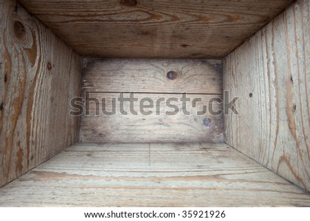 Interior of and old wooden box. Shot inside with wide angle - stock photo