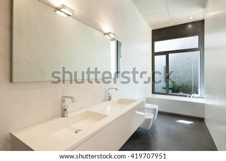 interior of apartment, modern bathroom with window - stock photo