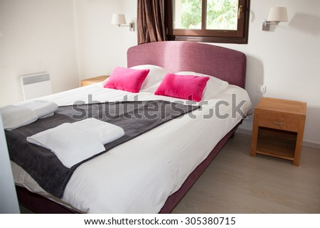 Interior of arranged double bed in a room