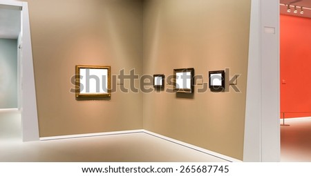 Interior of art gallery with paintings made in modern style