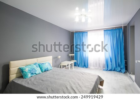Interior of bedroom. Modern minimalism style bedroom interior in monochrome tones - stock photo