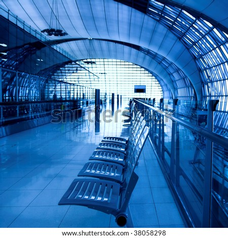 Interior of blue airport with metal seat - stock photo