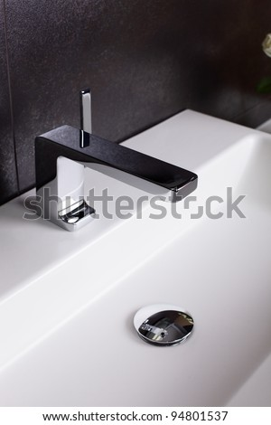 Interior of brand new bathroom with mirror - stock photo