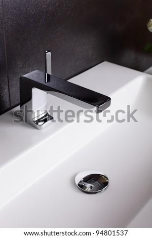 Interior of brand new bathroom with mirror - stock photo