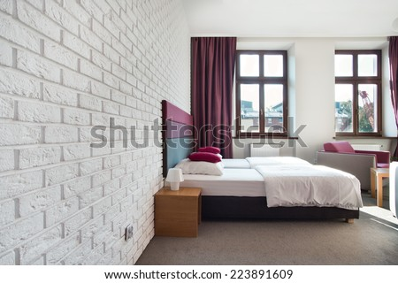 Interior of bright bedroom in the apartment - stock photo