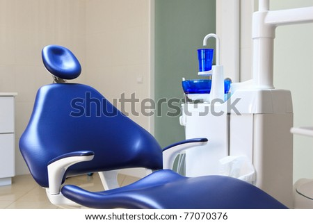 interior of bright dental office with blue chair - stock photo