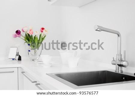 Interior of bright white kitchen - stock photo