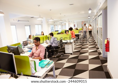 Interior Of Busy Modern Design Office - stock photo