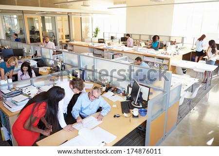 Interior Of Busy Modern Open Plan Office - stock photo