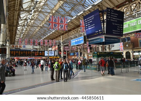 Interior of busy with commuters London Victoria Station Circa 2015 Victoria Station London railway terminus with crowds of travellers inside busy rail and underground station. - stock photo