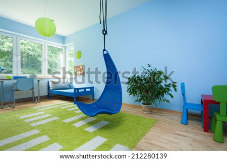interior of child room with hanging chair