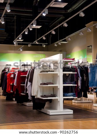 Interior of clothing store in the mall - stock photo