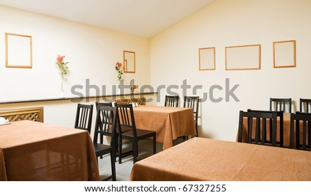 Interior of comfortable cafe with few table