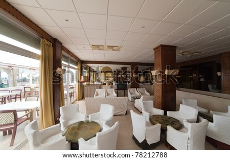 Interior of comfortable cafe with white arm-chair