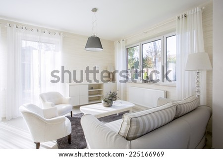 Interior of comfy and bright living room - stock photo