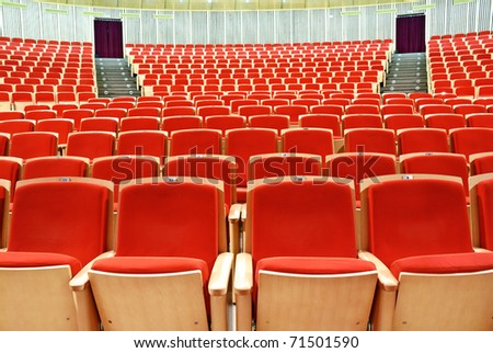 interior of conference hall with red velvet chairs