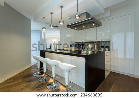 Interior of contemporary kitchen with designer chairs - stock photo