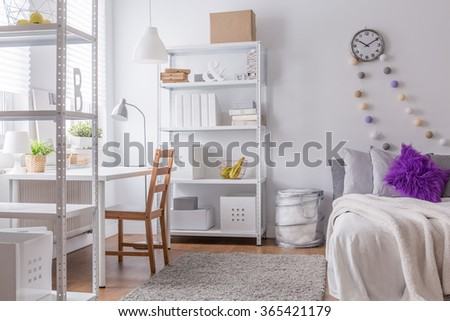 Interior of cozy bedroom for young woman - stock photo
