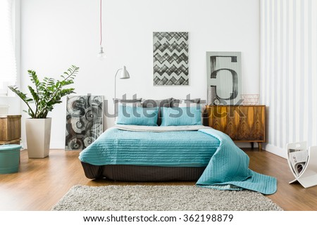 Interior of cozy bedroom in modern design - stock photo