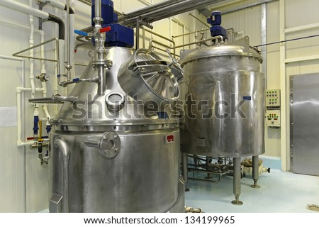 Interior of dairy factory with fermentation tank