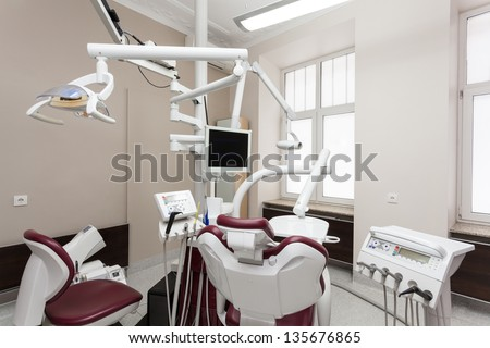 Interior of dental office with equipment - stock photo