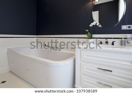 Interior of designer bathroom - stock photo