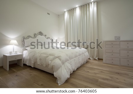 Interior of designer bedroom - stock photo