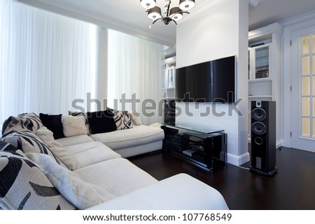 Interior of designer living room with tv - stock photo