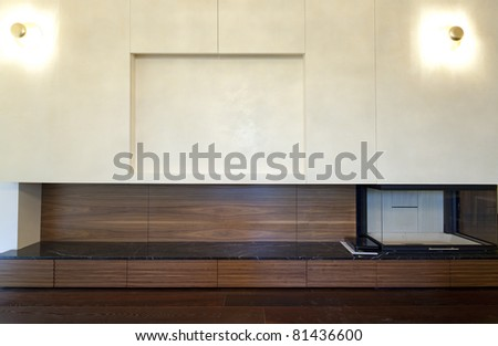 Interior of designer wall with fireplace and place for TV