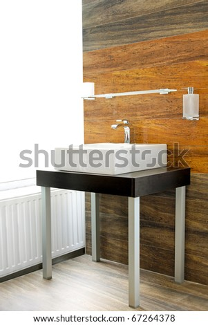 Interior of domestic bathroom with wooden walls - stock photo