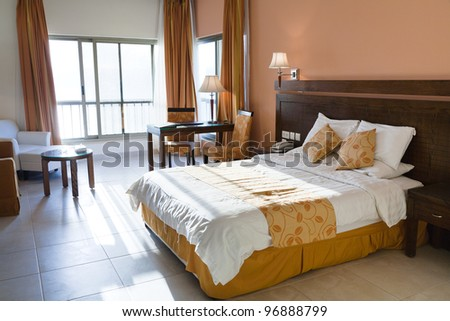 interior of double bed room - stock photo