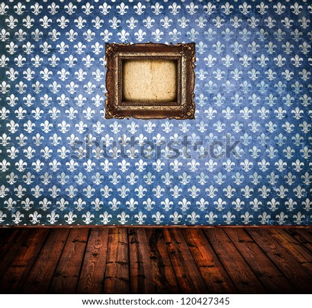 Interior of empty antique room woth wooden floor and blue damask wall with frame - stock photo
