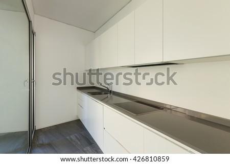 Interior of empty apartment, modern kitchen - stock photo