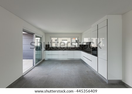 Interior of empty apartment, modern kitchen - stock photo
