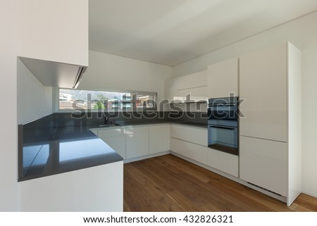 Interior of empty apartment, wide domestic kitchen - stock photo