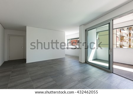 Interior of empty apartment, wide room with inside terrace - stock photo