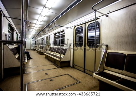 Interior of empty carriage Moscow subway. ISO 800, grain - stock photo