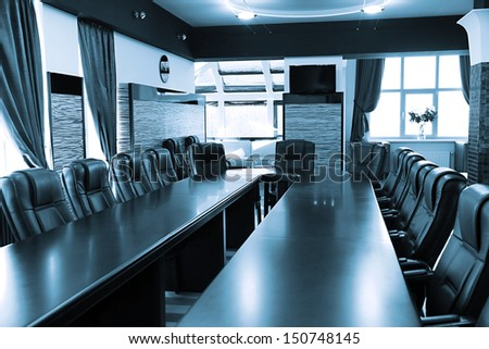 Interior of empty conference room in shades of grey - stock photo