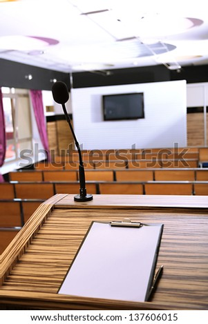 Interior of empty conference room with tribune - stock photo