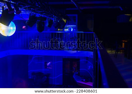 Interior of Empty Night Club Lit with Blue Lights
